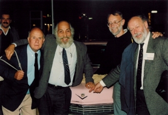 RAI244.1990.24 Jean Rouch, Herb di Gioia, David MacDougall and Colin Young at the 1990 Festival, with in the background, Janos Tari, then a student at the NFTS, copyright Knud Fischer-Moeller